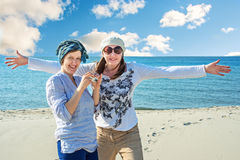 Two cheerful women walk by the sea Royalty Free Stock Photography