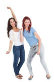 Two cheerful young female friends dancing Royalty Free Stock Photography
