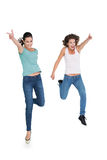 Two cheerful young female friends with hand gestures Royalty Free Stock Photography