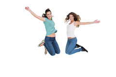 Two cheerful young female friends jumping Royalty Free Stock Images