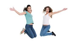 Two cheerful young female friends jumping Stock Image
