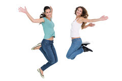 Two cheerful young female friends jumping Royalty Free Stock Photos