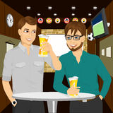 Two cheerful young men talking to each other. Sharing beer with good friend. Two cheerful young men talking to each other and gesturing while drinking beer at Royalty Free Stock Photos