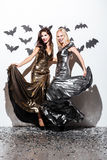 Two cheerful young women with halloween vampire makeup on party Stock Images