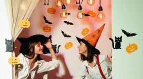 Two cheerful young women in witch halloween costumes dancing. Halloween Party girl. Celebrations dresses and witch stock image