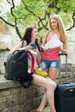Two cheerfull girls with map Stock Photography
