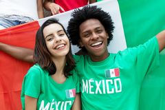 Two cheering mexican soccer fans with flag of mexico Royalty Free Stock Image