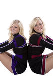 Two cheerleaders closeup back to back Stock Image