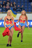 Two cheerleaders dancing on the field Royalty Free Stock Images