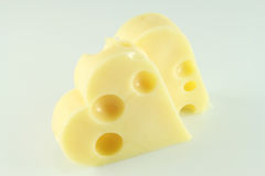 Two cheese heart. Two piece cheese heart, isolated Royalty Free Stock Photography