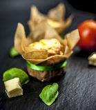 Two cheese muffins, basil, tomato and cheese Stock Photography