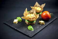 Two cheese muffins, basil, tomato and cheese Royalty Free Stock Images