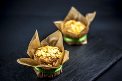 Two cheese muffins. On black background Stock Photo