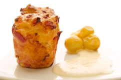 Two cheese muffins with pickled grapes and sauce Royalty Free Stock Photography