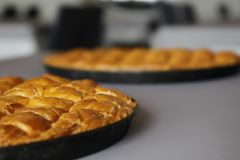 Two Cheese pies on pan. Traditional greek Cheese pies on pan Stock Images