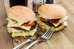 Two Cheeseburger on wooden background Royalty Free Stock Image