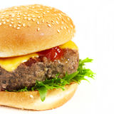Two cheeseburgers on wooden table Stock Image
