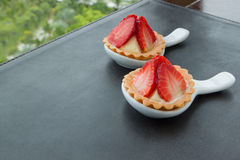 Two cheesecake with strawberries , sweet bread. Two cheesecake with strawberries on table Stock Photography