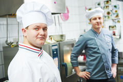 Two chef cook at kitchen royalty free stock photo
