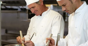 Two chef preparing a meal. In the kitchen stock footage