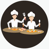 Two chef working together prepare for the dish food in restaurant table Royalty Free Stock Photos