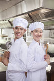 Two Chefs Back to Back Stock Photo