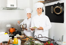 Two chefs cooking food Stock Image