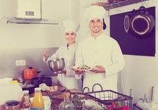 Two chefs cooking food Royalty Free Stock Image