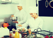 Two chefs cooking food Stock Photo