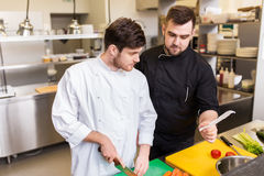 Two chefs cooking food at restaurant kitchen Royalty Free Stock Image