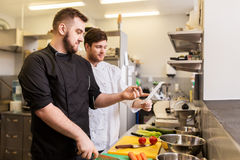 Two chefs cooking food at restaurant kitchen Royalty Free Stock Images