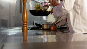 Two chefs cooking and working stock footage