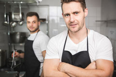 Two chefs in kitchen Royalty Free Stock Image
