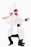 Two chefs with kitchen utensils. Funny people isolated on white Royalty Free Stock Photos