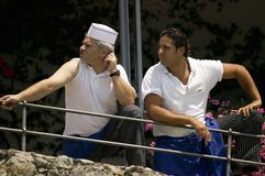 Two chefs looking to their side in Amalfi, Italy, Europe Stock Photos