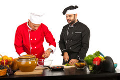 Two chefs preparing food Royalty Free Stock Photography