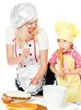 Two chefs rubs cream cake Stock Photo