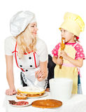 Two chefs rubs cream cake Stock Photography