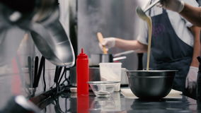 Two chefs working in a restaurant kitchen. stock footage