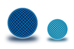 Two chekered spheres in the comparative form Royalty Free Stock Image