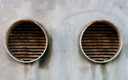 Two chemical pipes. The ending of two chemical industrial pipes for air diffusion on a concrete wall stock photos