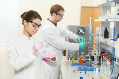 Two Chemist Researchers Workers In Laboratory Stock Photos