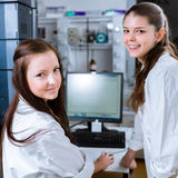 Two chemistry students carrying out experiments in a lab Royalty Free Stock Photo