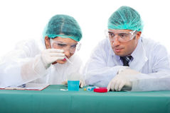 Two chemists making experiments. Two chemists people team making experiments in laboratory Stock Photography