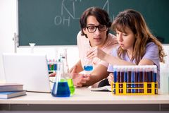 The two chemists students in classroom. Two chemists students in classroom royalty free stock photo