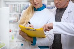 Two chemists working at drugstore together royalty free stock images