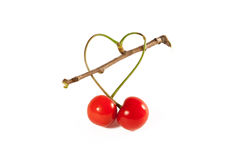 Two cherries  into a heart love. Two cherries into a heart love isolated on white Stock Photos