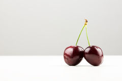 Two cherries on joined stalk Stock Photos
