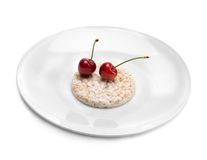 Two cherries on a plate Stock Images