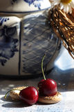Two cherries in rustic russian interior details Stock Photos